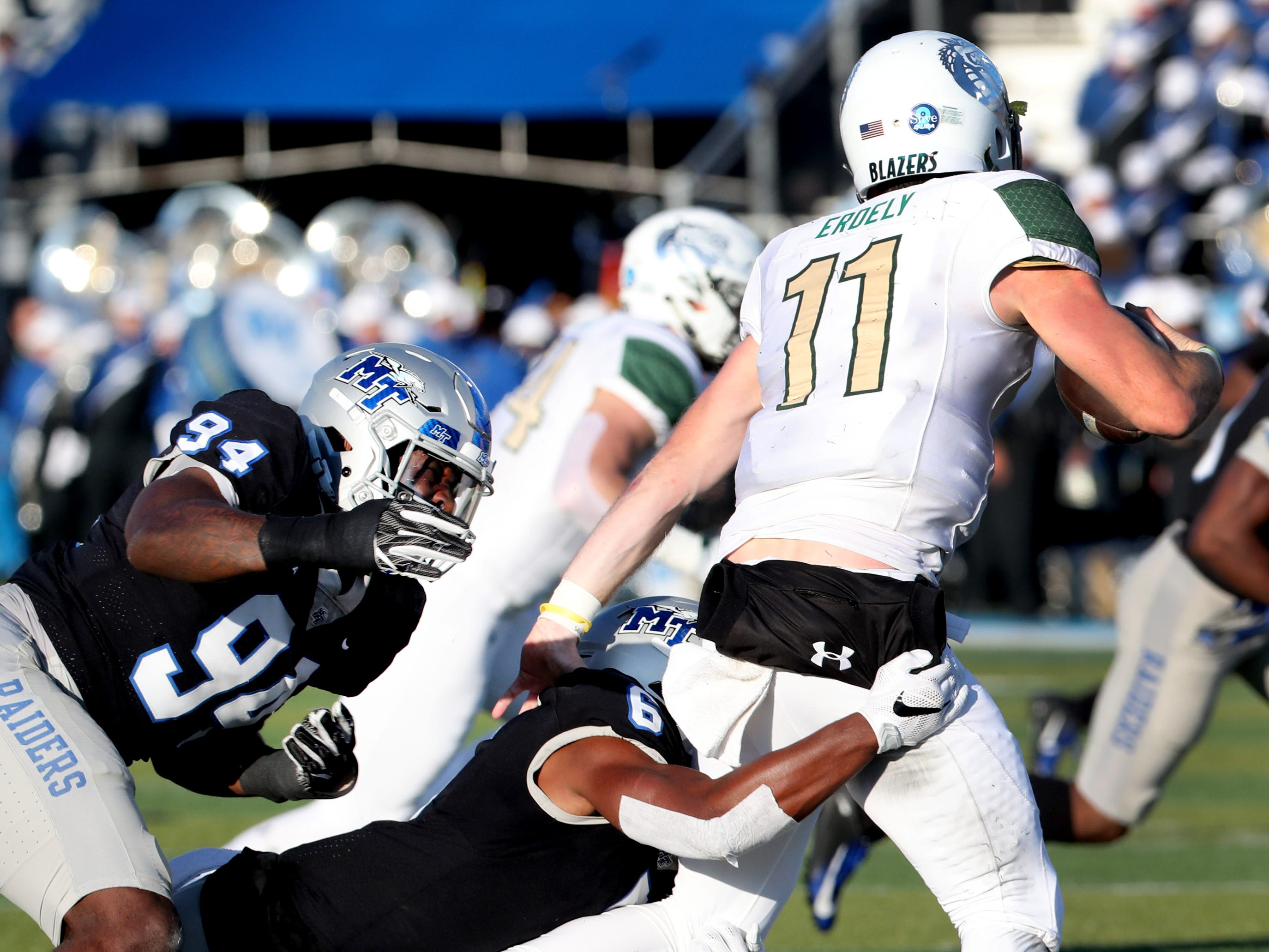 UAB's quarterback AJ Erdely (11) is sacked by MTSU's Tyshun Render (94) and Khalil Brooks (6) during the game at MTSU on Saturday, Nov. 24, 2018.