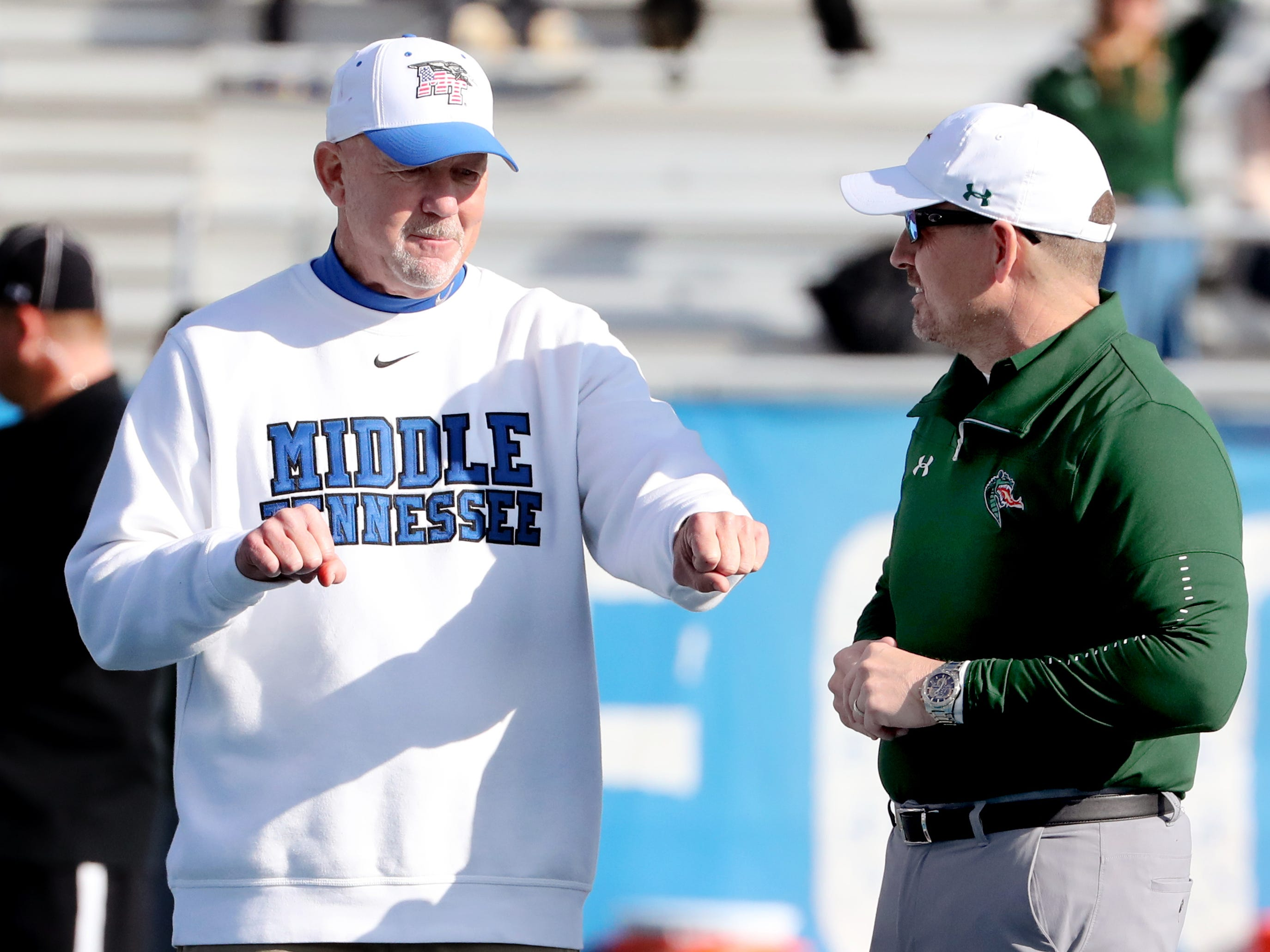 MTSU's head coach Rick Stockstill talks with UAB's head coach Bill Clark before the game at MTSU on Saturday, Nov. 24, 2018.
