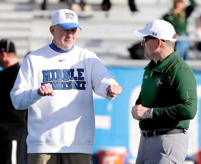 MTSU coach Rick Stockstill, left, talks with UAB coach Bill Clark before their game Saturday at MTSU.
