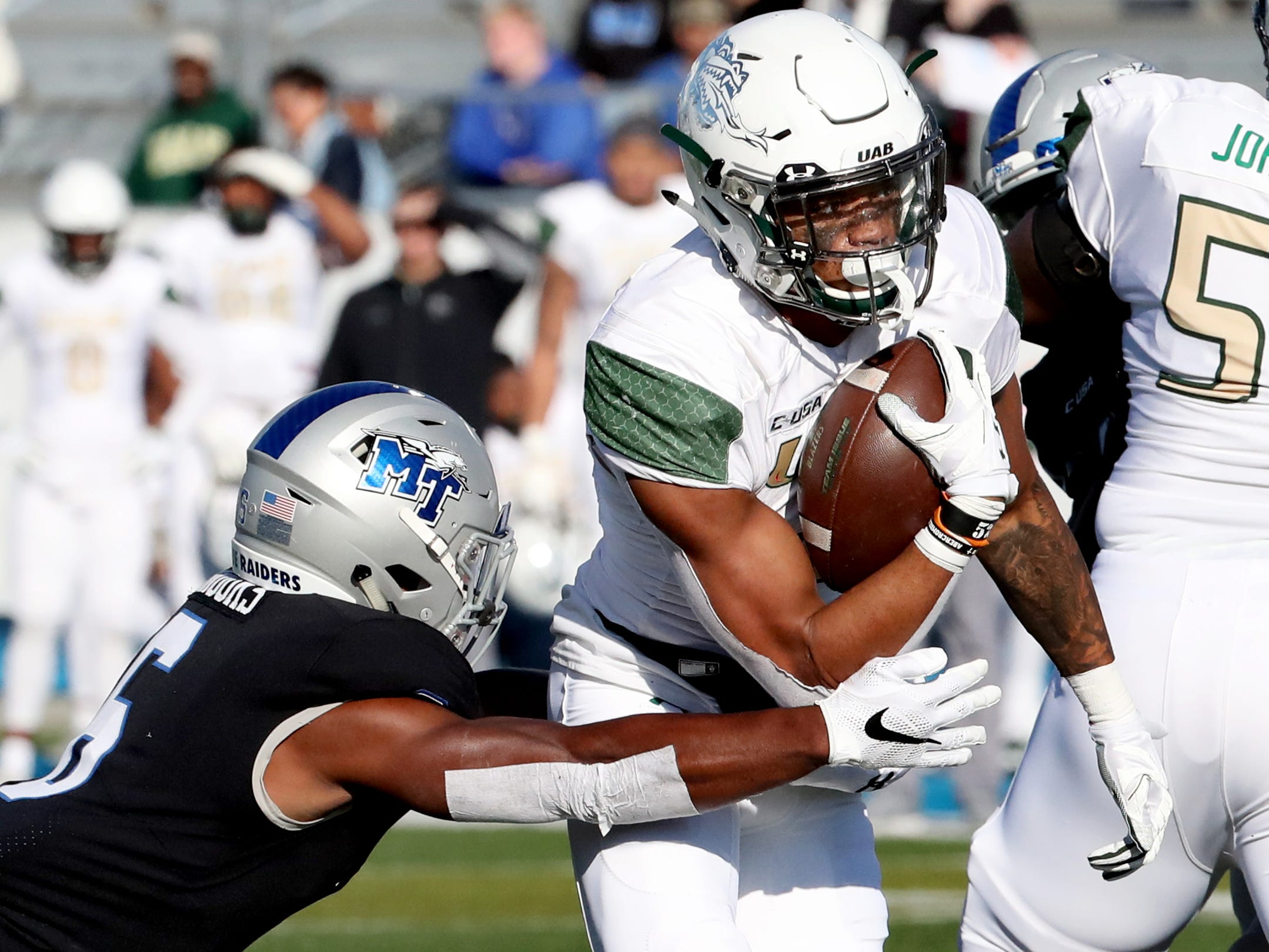 MTSU's Khalil Brooks (6) tackles UAB's Jarrion Street (5) during the game at MTSU on Saturday, Nov. 24, 2018.