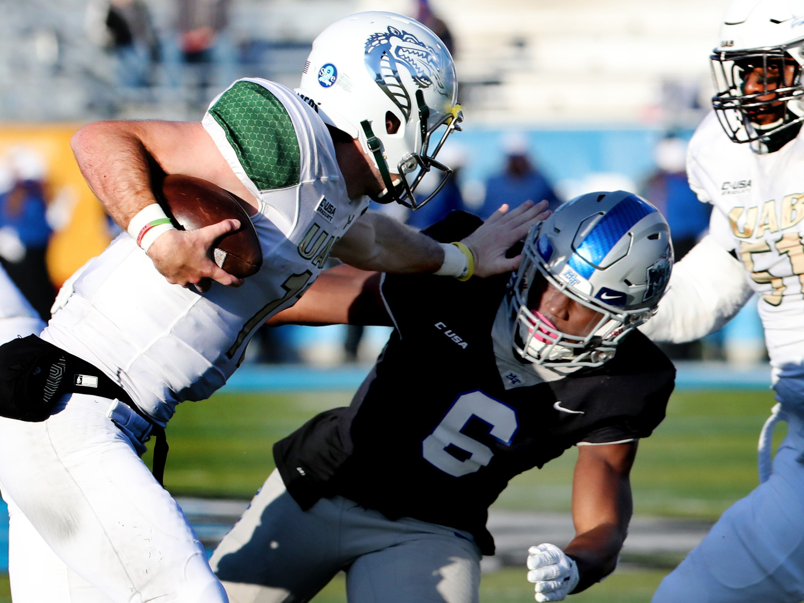 MTSU's Khalil Brooks (6) moves in to tackle UAB's quarterback AJ Erdely (11) during the game at MTSU on Saturday, Nov. 24, 2018.