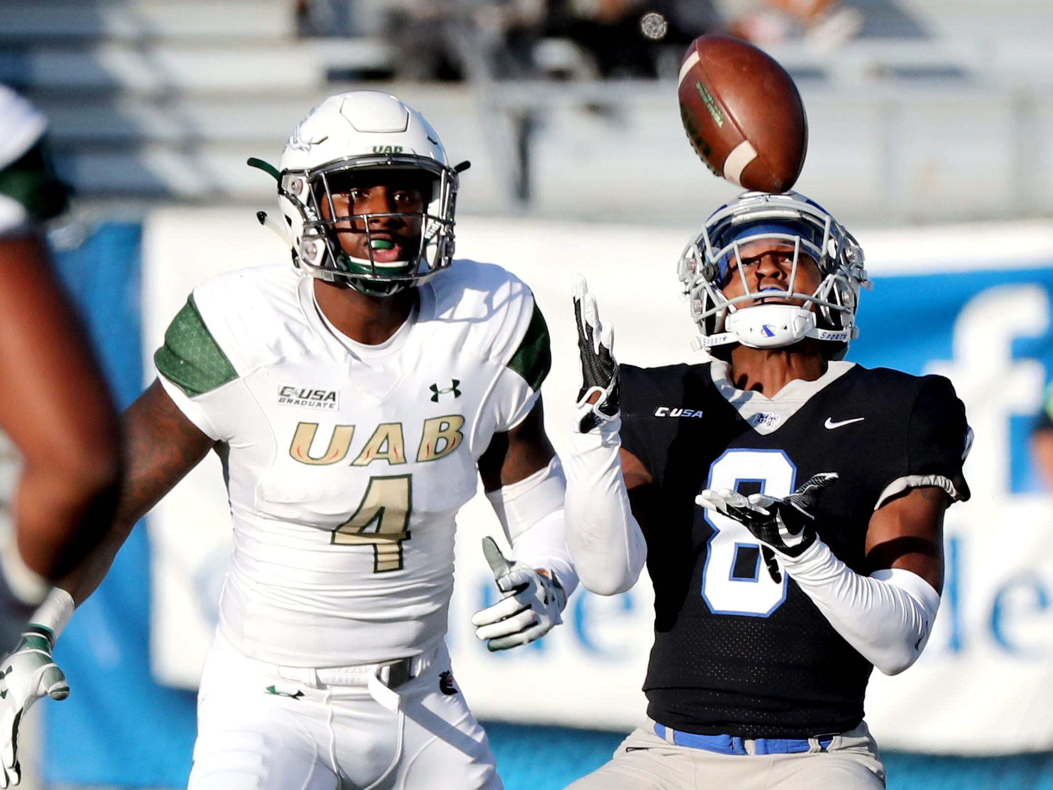 MTSU's Ty Lee (8) catches a punt return as UAB's Starling Thomas V (4) watches behind him during the game at MTSU on Saturday, Nov. 24, 2018.