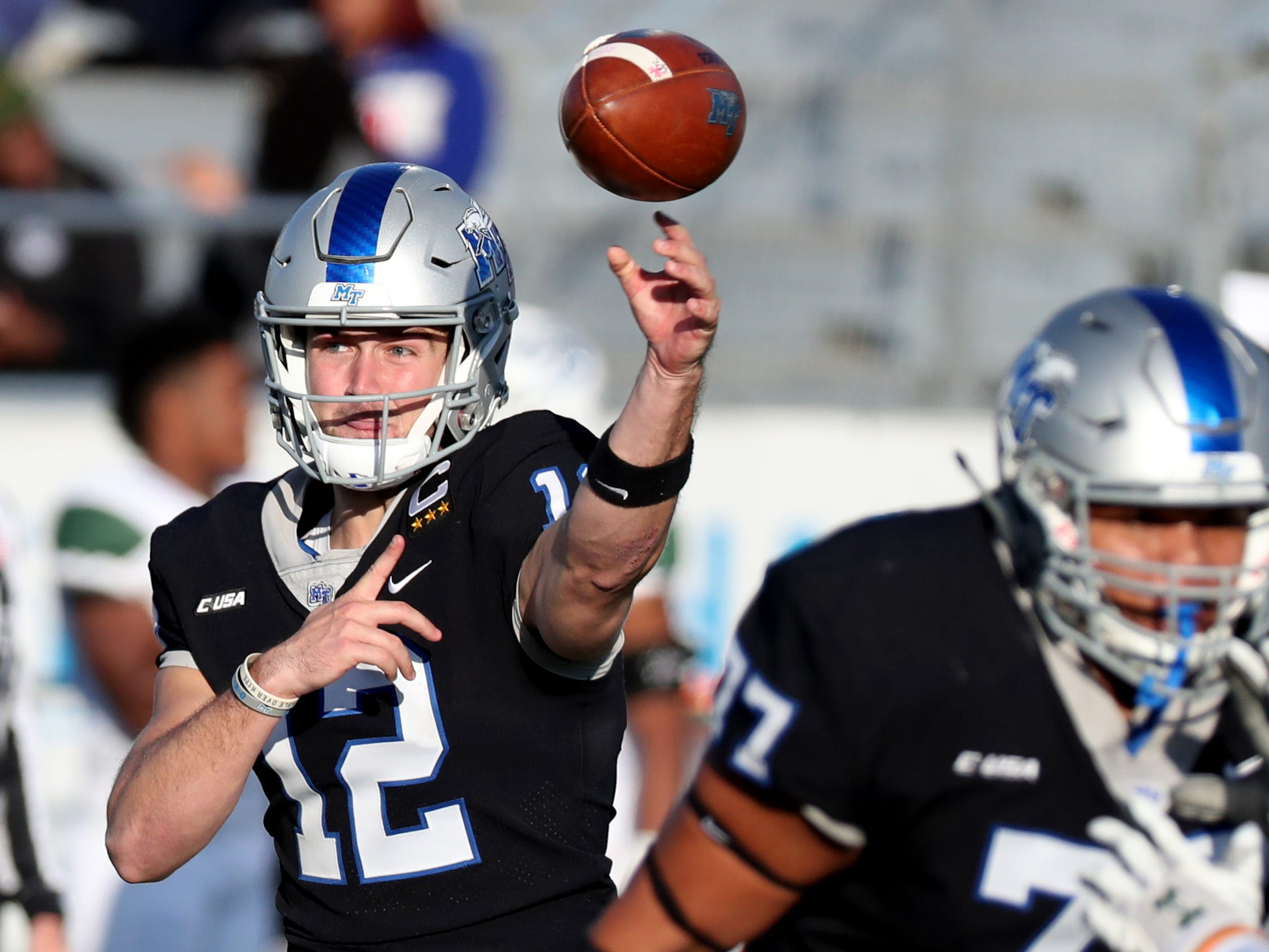 MTSU's quarterback Brent Stockstill (12) passes the ball during the game against UAB at MTSU on Saturday, Nov. 24, 2018.