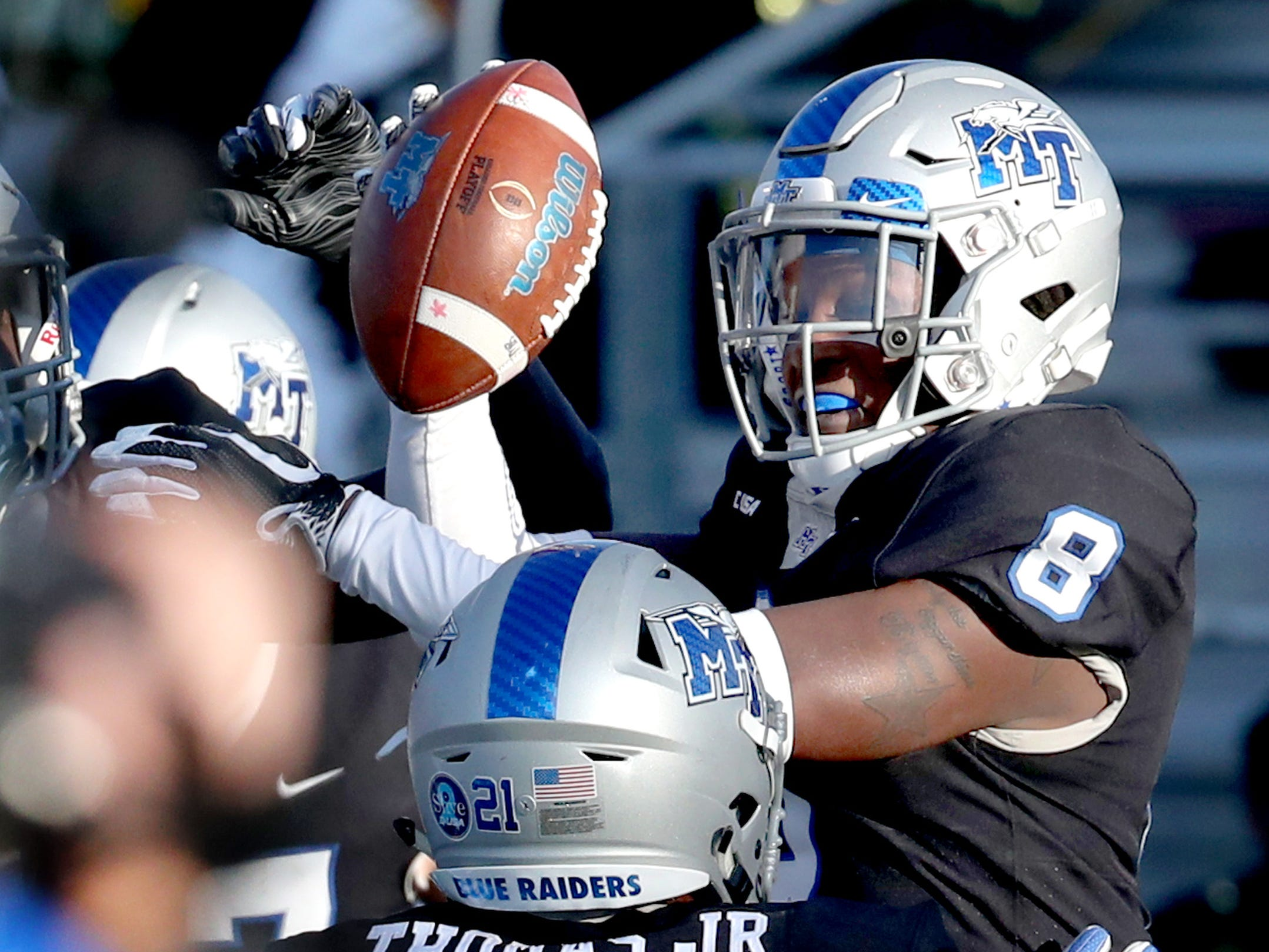 MTSU's Ty Lee (8) is lifted into the air by Tavares Thomas after Lee scored a touchdown against UAB during the game at MTSU on Saturday, Nov. 24, 2018.