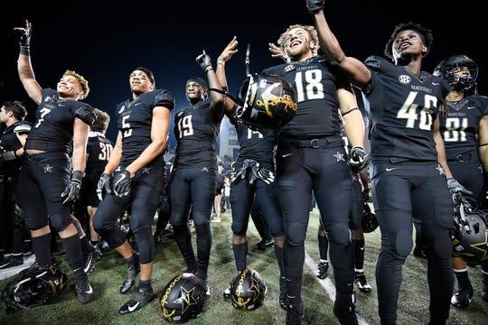 Vanderbilt players celebrate the 38-13 win over Tennessee at Vanderbilt Stadium Saturday, Nov. 24, 2018, in Nashville, Tenn.