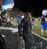 Vanderbilt head coach Derek Mason is doused after the win over Tennessee at Vanderbilt Stadium Saturday, Nov. 24, 2018, in Nashville, Tenn.