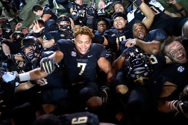 Vanderbilt players celebrate the 38-13 win over Tennessee at Vanderbilt Stadium Saturday, Nov. 24, 2018, in Nashville, Tenn.