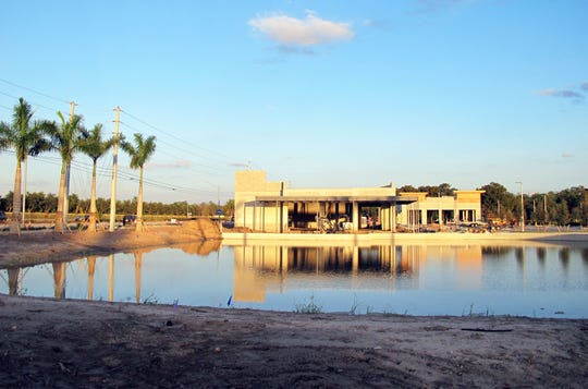 The freestanding Oak & Stone restaurant and bar is adjacent to a water feature at the new Logan Landings retail center under construction on the southeast corner of Logan Boulevard and Immokalee Road in North Naples.