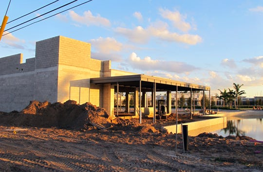 The freestanding Oak & Stone restaurant and bar is next to a water feature at the new Logan Landings retail center under construction on the southeast corner of Logan Boulevard and Immokalee Road in North Naples.