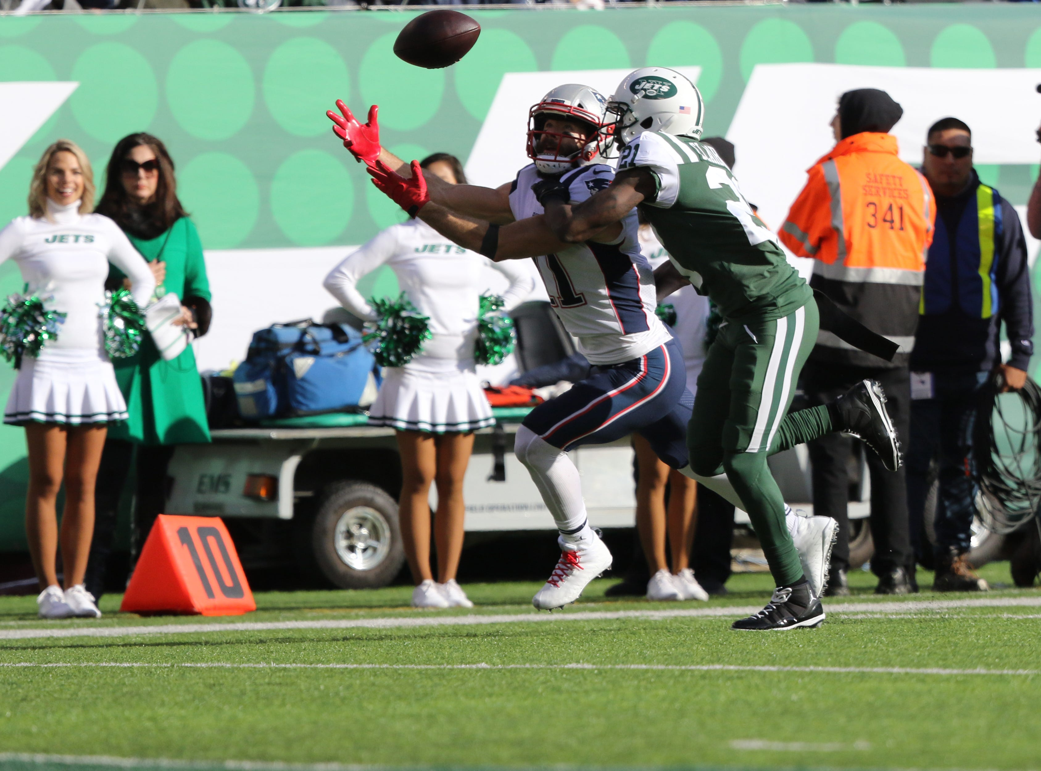 Julian Edelman, of the Patriots, is unable to catch the pass meant for him in the first half as Morris Claiborne, of the Jets, plays tight defense, during the first half. Sunday, November 25, 2018