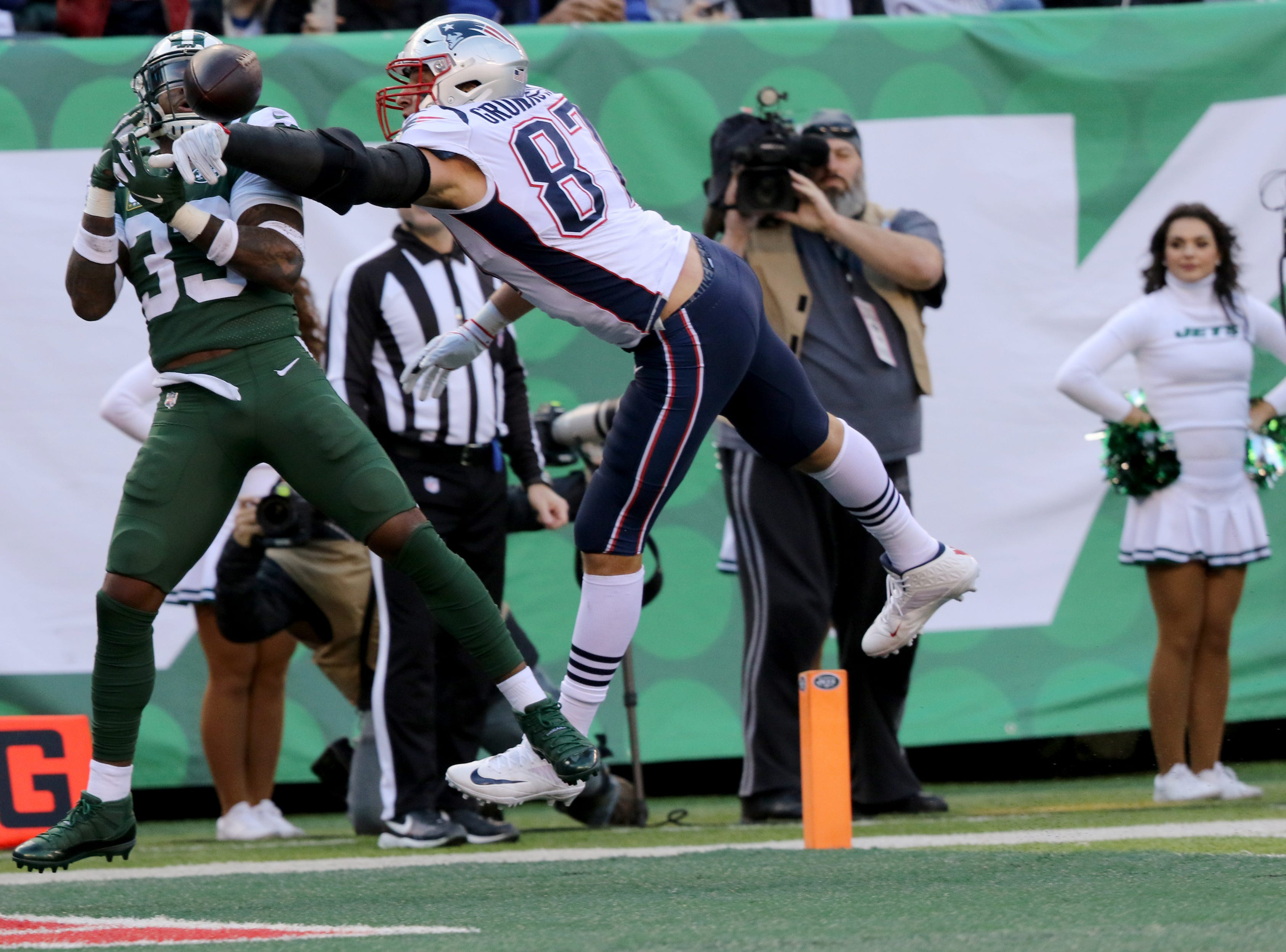 Rob Gronkowski, of the Patriots makes sure Jamal Adams, of the Jets, doesn't intercept the ball in the endzone. November 25, 2018.