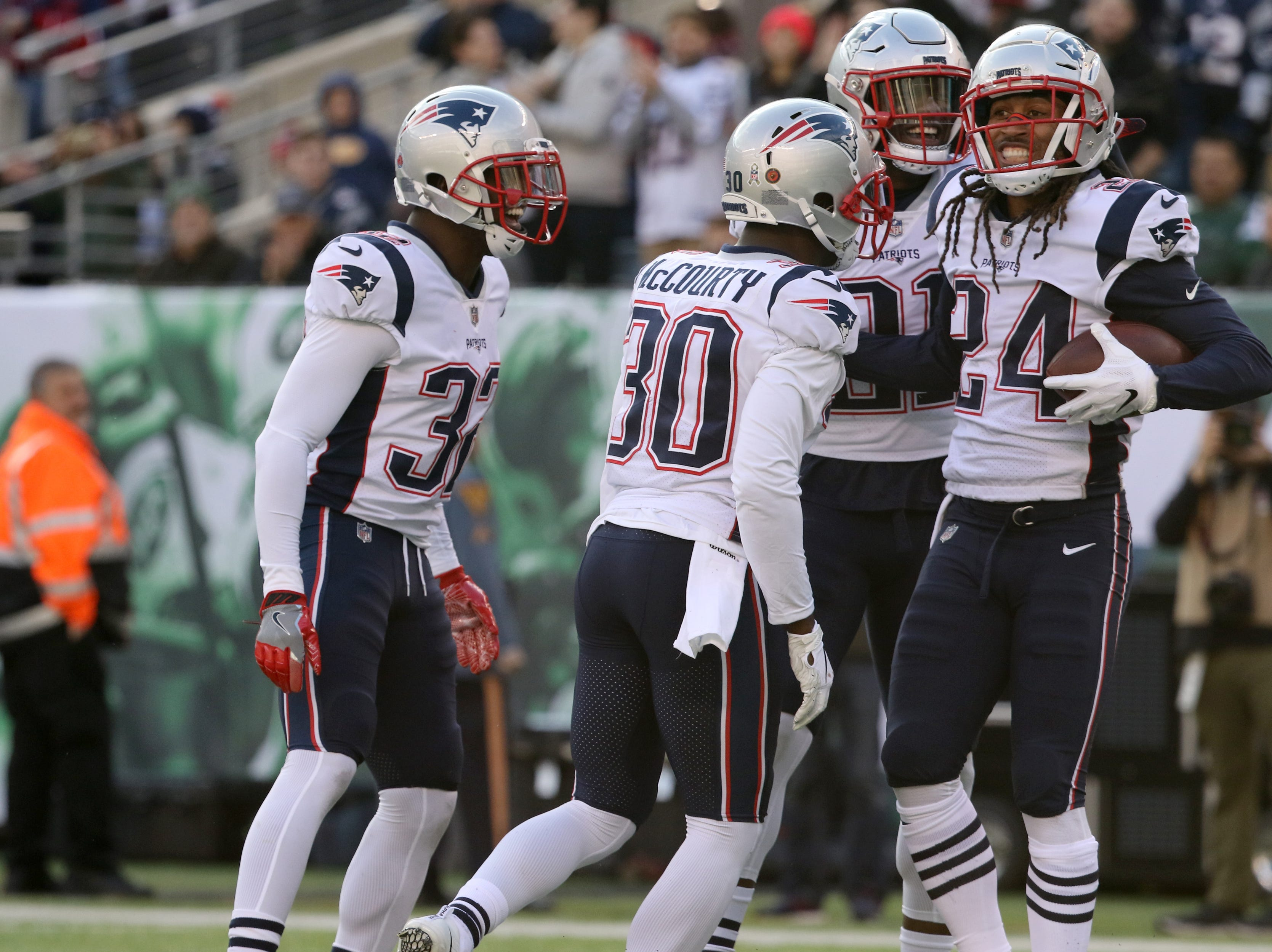 Stephon Gilmore (24), is surrounded by his Patriots teammates after catching a long pass. Sunday, November 25, 2018