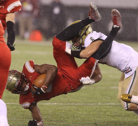 Rahmir Johnson of Bergen Catholic is tackled by Frankie Monte of St. Joseph in the first half of the Non-Public, Group 4 championship at MetLife Stadium in East Rutherford on Saturday, Nov. 24, 2018.