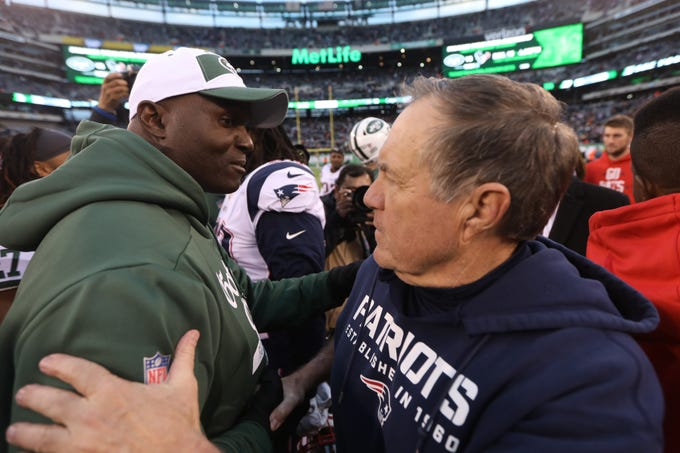 Jets Head Coach Todd Bowles and Patriots Head Coach Bill Belichick, greet each other at midfield after the game. Sunday, November 25, 2018