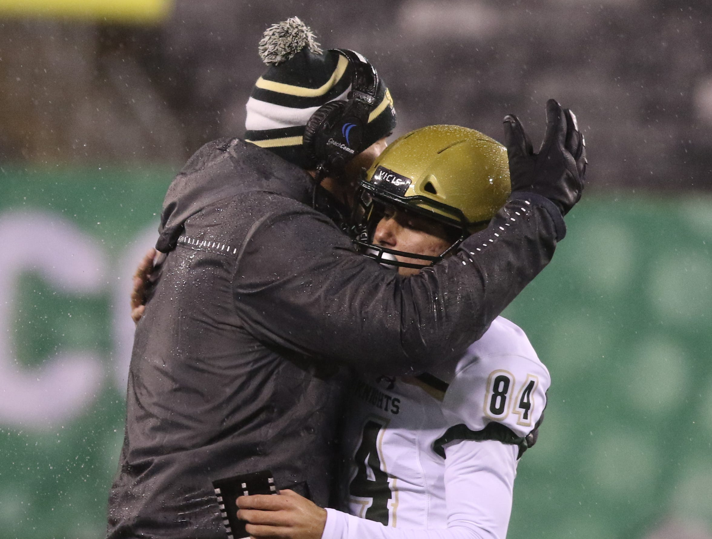 St. Joseph coach Augie Hoffmann with kicker Angelo Guglielmello of St.Joseph after he hit the extra point that broke the state career kicking points record.