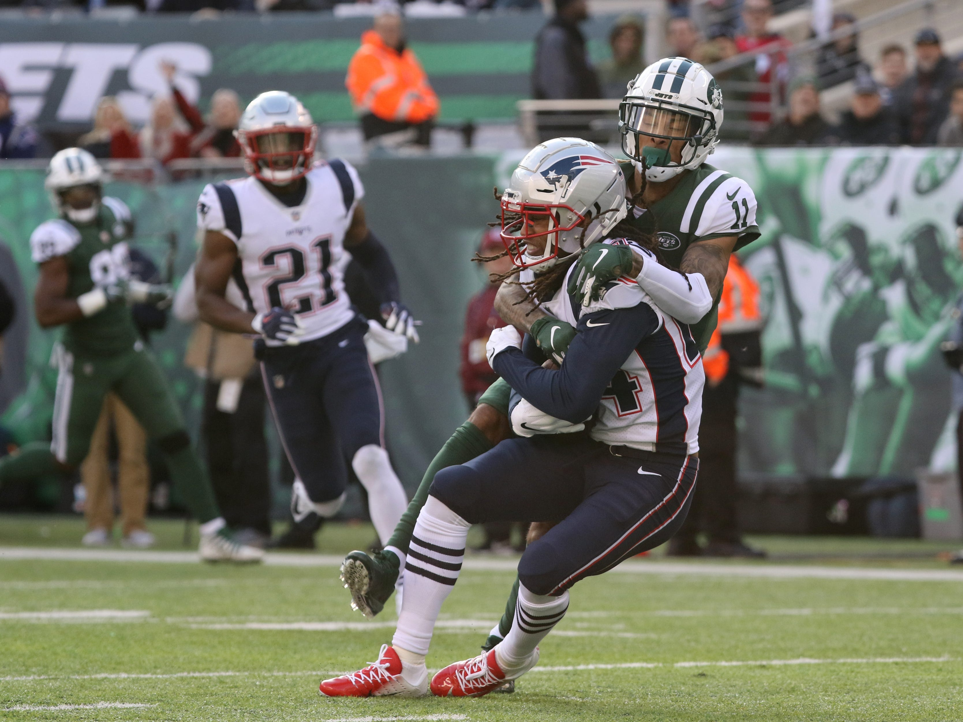Robby Anderson, of the Jets was unable to intercept a pass meant for Stephon Gilmore of the Patriots, in the first half. Sunday, November 25, 2018