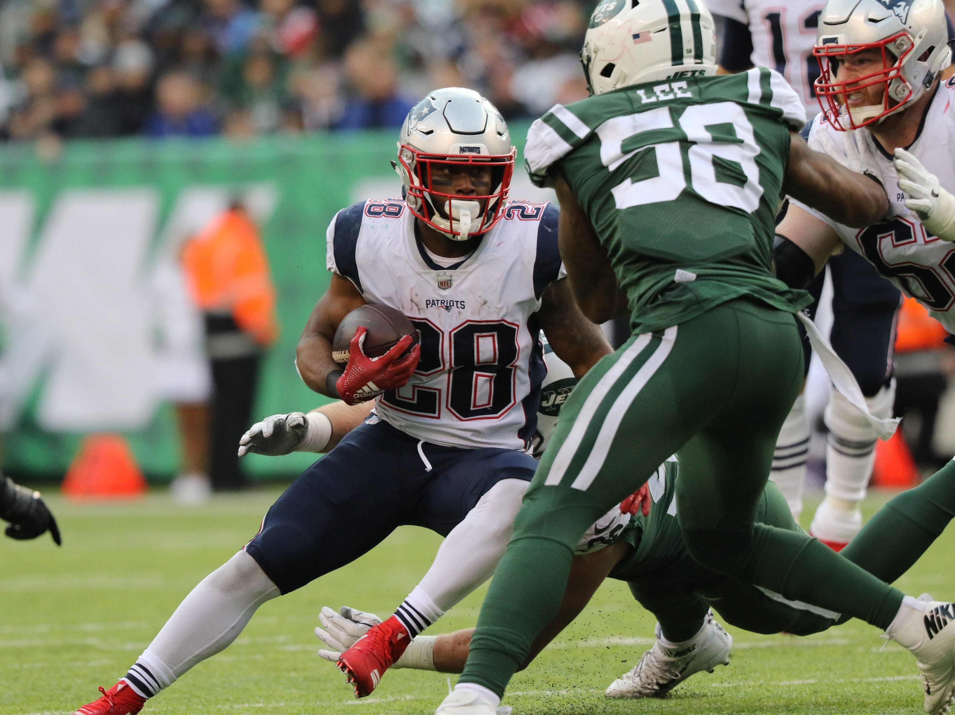 James White runs the ball for the Patriots during the second half. Sunday, November 25, 2018