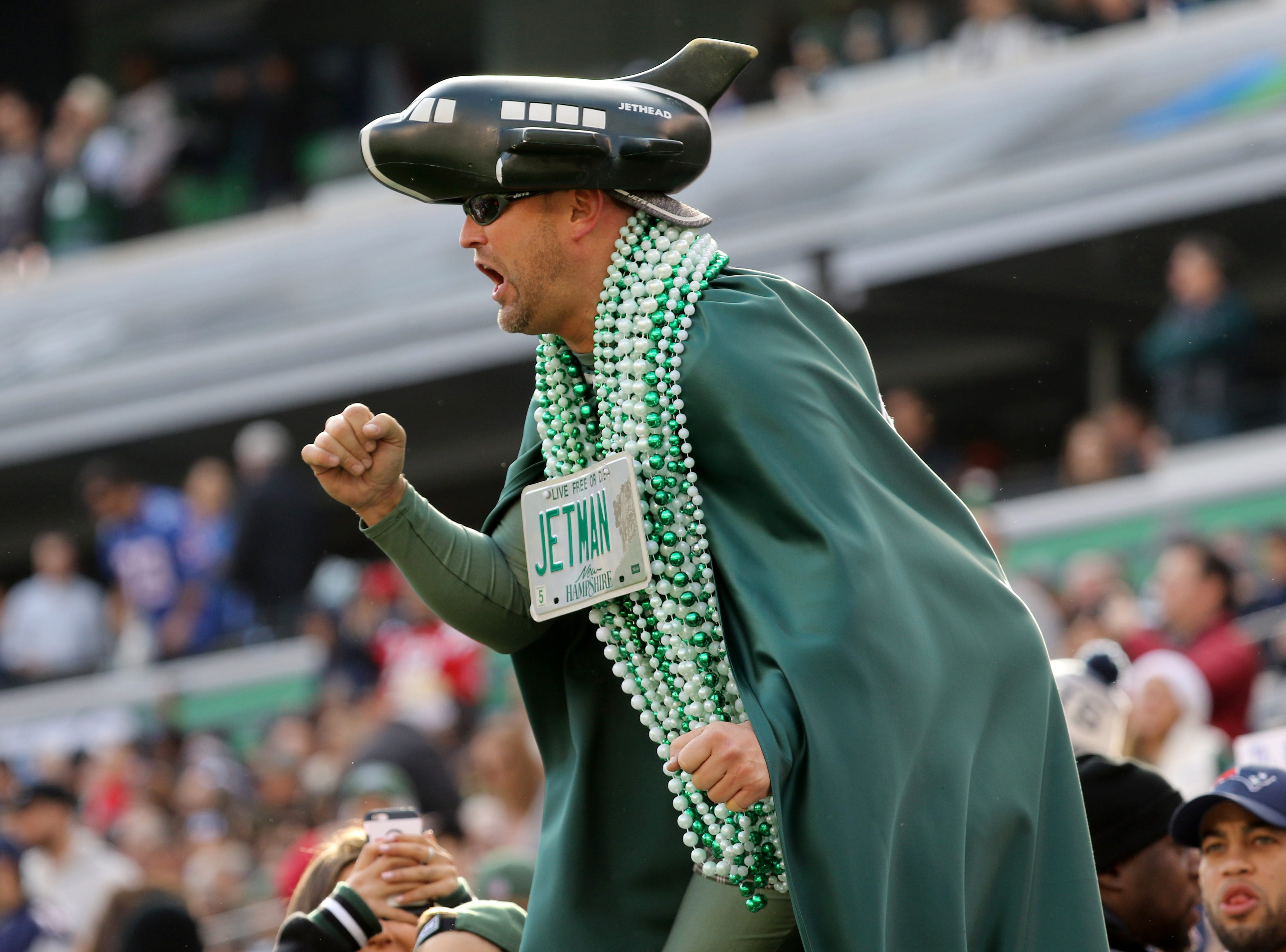 """Jets Man"" cheers on his team during the first half. Sunday, November 25, 2018"
