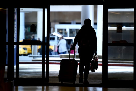 The Transportation Security Administration is expecting Sunday to be the busiest day for Thanksgiving travel as people return home to head back to work after the holiday. A traveler leaves Newark Liberty International Airport on Sunday, November 25, 2018.