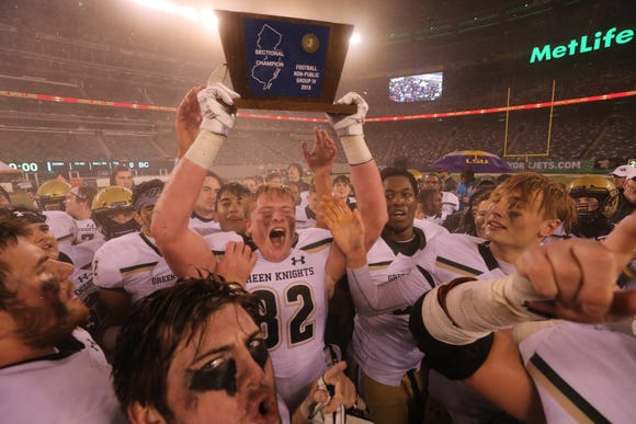 Brady Roark of St. Joseph holds up the trophy as his team wins the Non-Public, Group 4 state championship with a 13-0 win over Bergen Catholic at MetLife Stadium in East Rutherford on Saturday, Nov. 24, 2018.