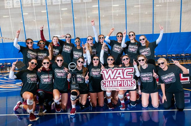 The New Mexico State volleyball team celebrates winning the Western Athletic Conference Tournament title on Saturday night in Bakersfield, California.