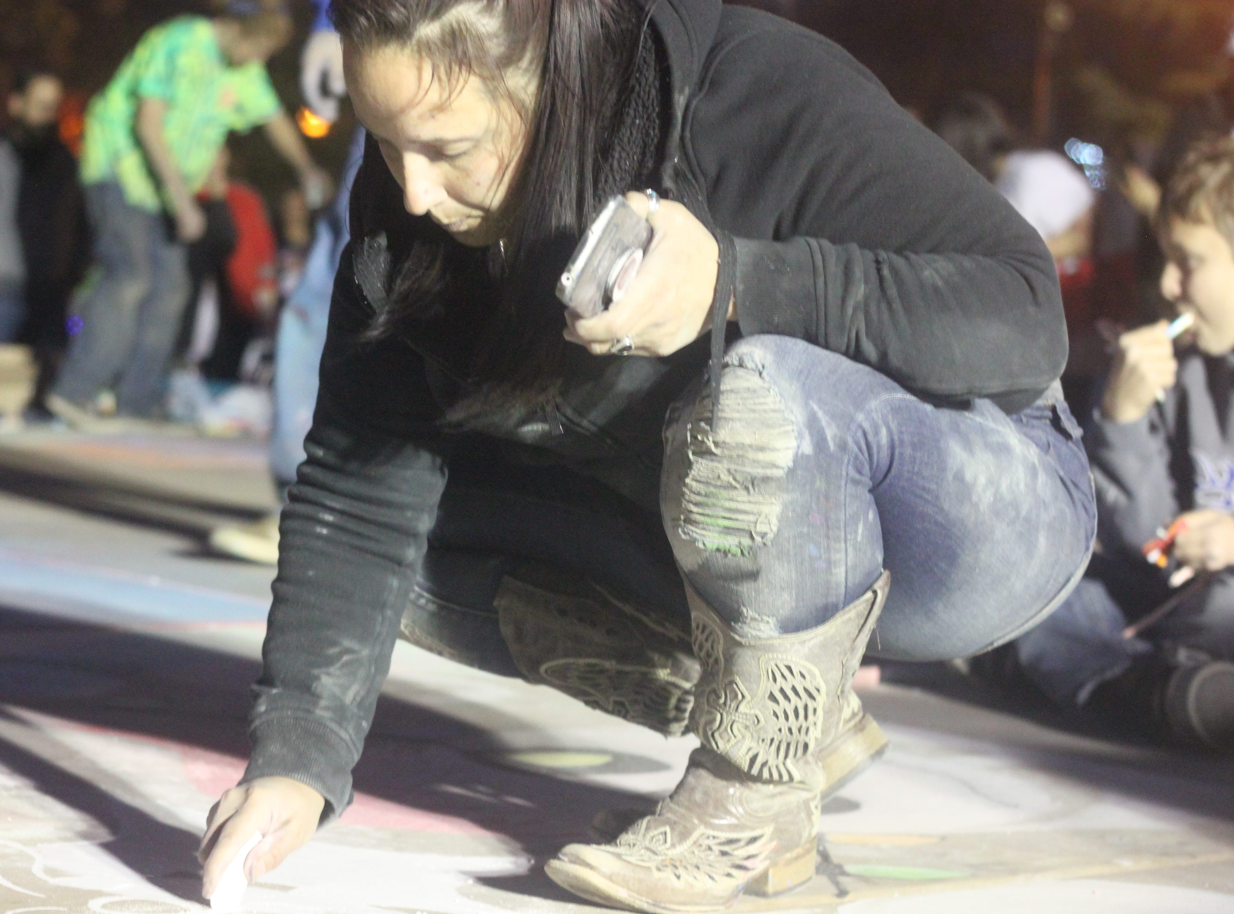 Locals take part in a sidewalk chalk contest, Nov. 24, 2018 at Halagueno Arts Park.