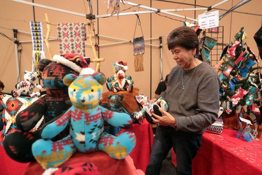 Colleen Anderson, of Bellflower with a teddy bears she sells in her family's booth at the 37th Indio Powwow at Fantasy Springs Resort and Casino in Indio on Saturday November 24, 2018.