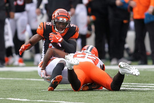 CINCINNATI, OH - NOVEMBER 25:  John Ross #15 of the Cincinnati Bengals is tackled by Damarious Randall #23 of the Cleveland Browns during the first quarter at Paul Brown Stadium on November 25, 2018 in Cincinnati, Ohio. (Photo by John Grieshop/Getty Images)