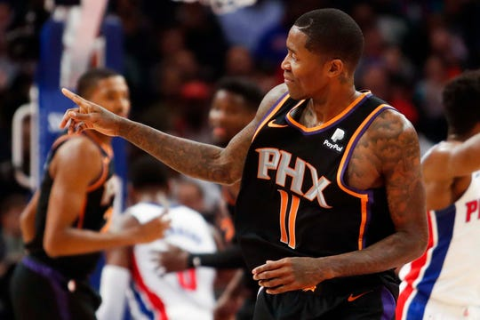 Suns guard Jamal Crawford points to his bench after making a shot during the second quarter of a game against the Pistons.