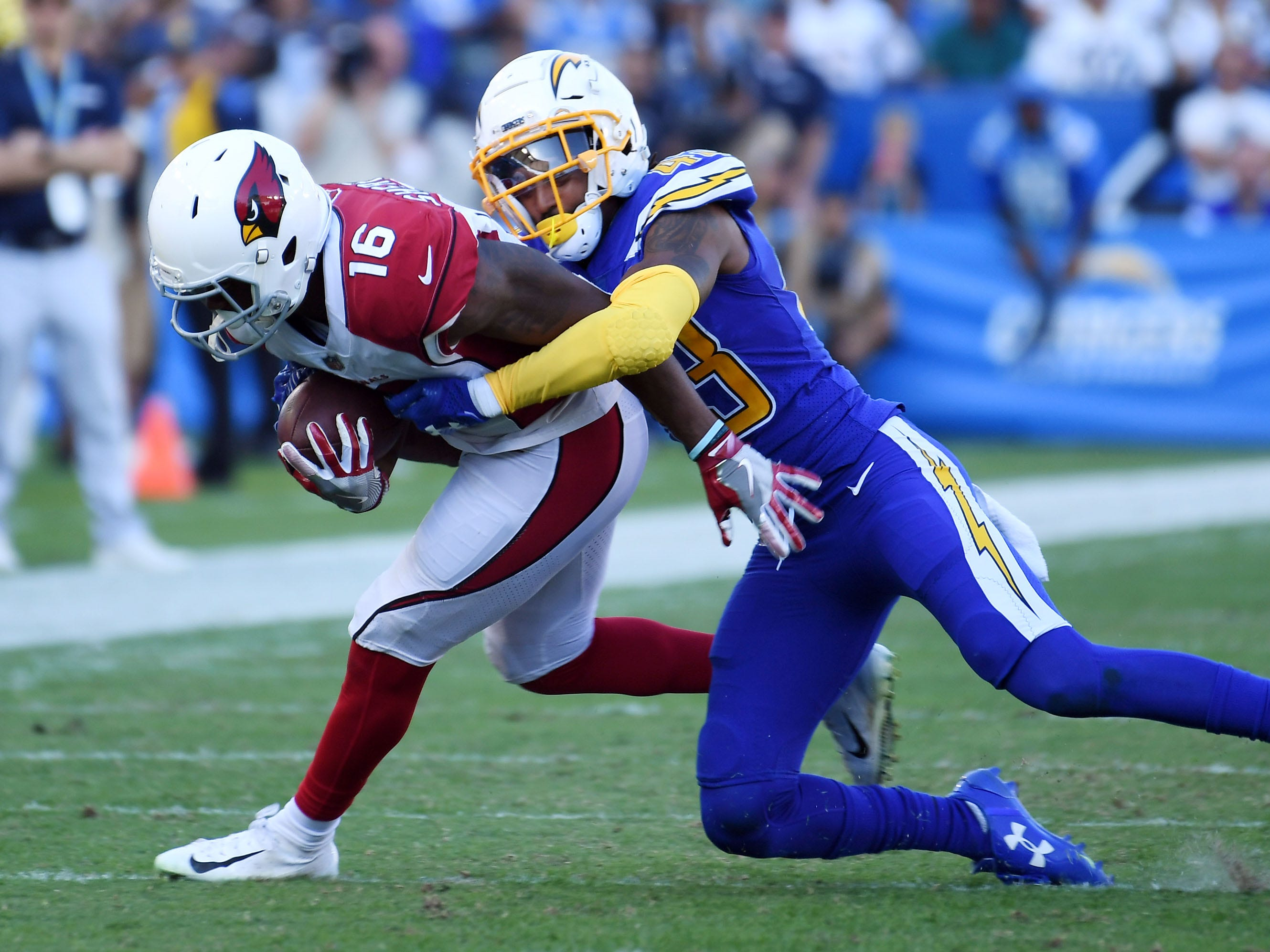 Nov 25, 2018; Carson, CA, USA; Arizona Cardinals wide receiver Trent Sherfield (16) is tackled by Los Angeles Chargers cornerback Michael Davis (43) in the first half at the StubHub Center. Mandatory Credit: Richard Mackson-USA TODAY Sports