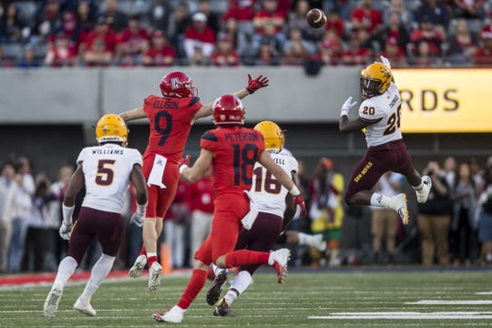 Arizona's Tony Ellison reaches for a pass that was intercepted by Arizona State's Aashari Crosswell during the second half of the Territorial Cup on Saturday, Nov. 24, 2018, at Arizona Stadium in Tucson, Ariz. Arizona State won, 41-40.