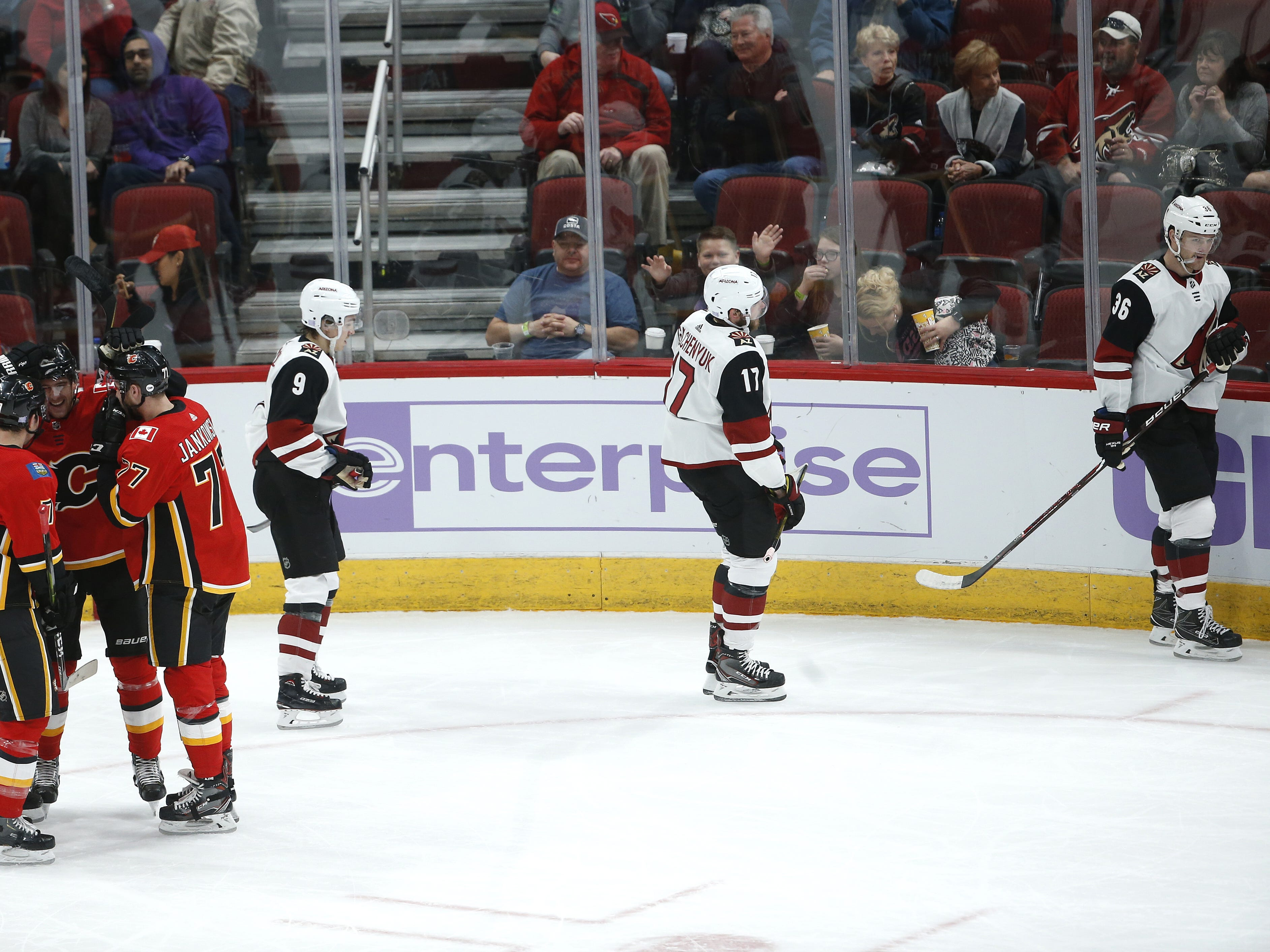 The Flames celebrate a short-handed goal against the Coyotes during the first period at Gila River Arena in Glendale, Ariz. on November 25, 2018.