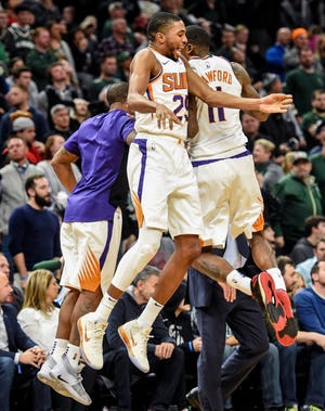 Nov 23, 2018:  Phoenix Suns forward Mikal Bridges (25) and guard Jamal Crawford (11) celebrate after Crawford's game-winning basket in the last second of the game at the Fiserv Forum.