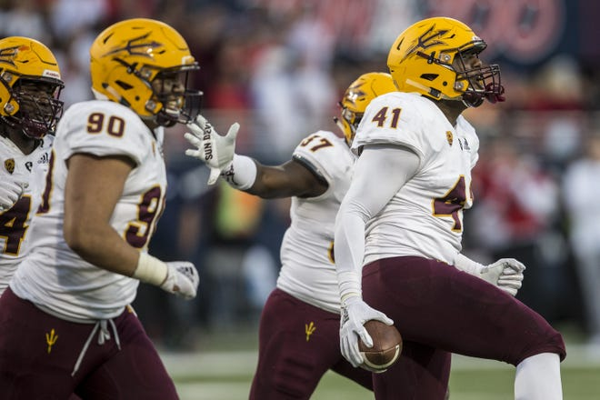 Arizona State's Tyler Johnson celebrates after recovering a fumble against Arizona during the second half of the Territorial Cup on Saturday, Nov. 24, 2018, at Arizona Stadium in Tucson, Ariz. Arizona State won, 41-40.