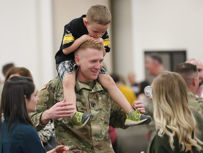 Cap. Jordan Spence carries his nephew, Keith, 5, on his shoulders during a departure ceremony for the 158th Military Engagement Team Det. 1 in Phoenix Sunday. The 25-member team is deploying overseas for about nine months in support of U.S. Central Command.