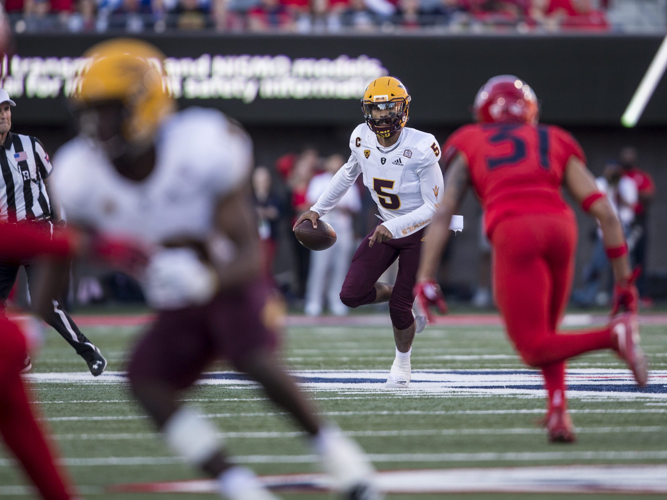 Arizona State's Manny Wilkins looks to pass against Arizona during the second half of the Territorial Cup on Saturday, Nov. 24, 2018, at Arizona Stadium in Tucson, Ariz. Arizona State won, 41-40.