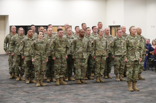 The 158th Military Engagement Team Det. 1 stands at attention during a departure ceremony in Phoenix. The 25-member team is deploying overseas for about nine months in support of U.S. Central Command.