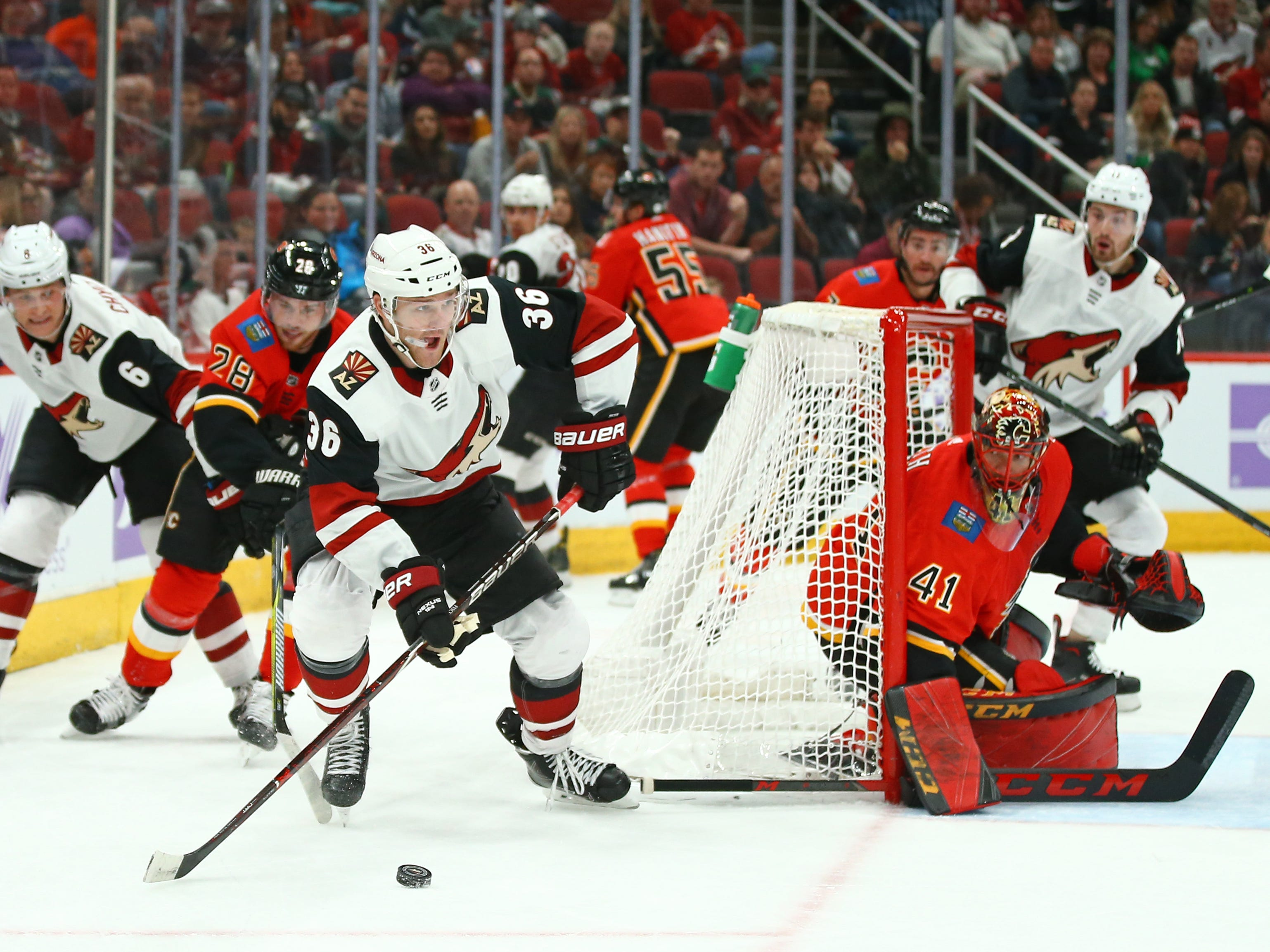 Nov 25, 2018; Glendale, AZ, USA; Arizona Coyotes right wing Christian Fischer (36) moves the puck against the Calgary Flames in the first period at Gila River Arena. Mandatory Credit: Mark J. Rebilas-USA TODAY Sports