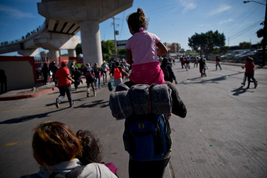 Migrants attempt to cross border
