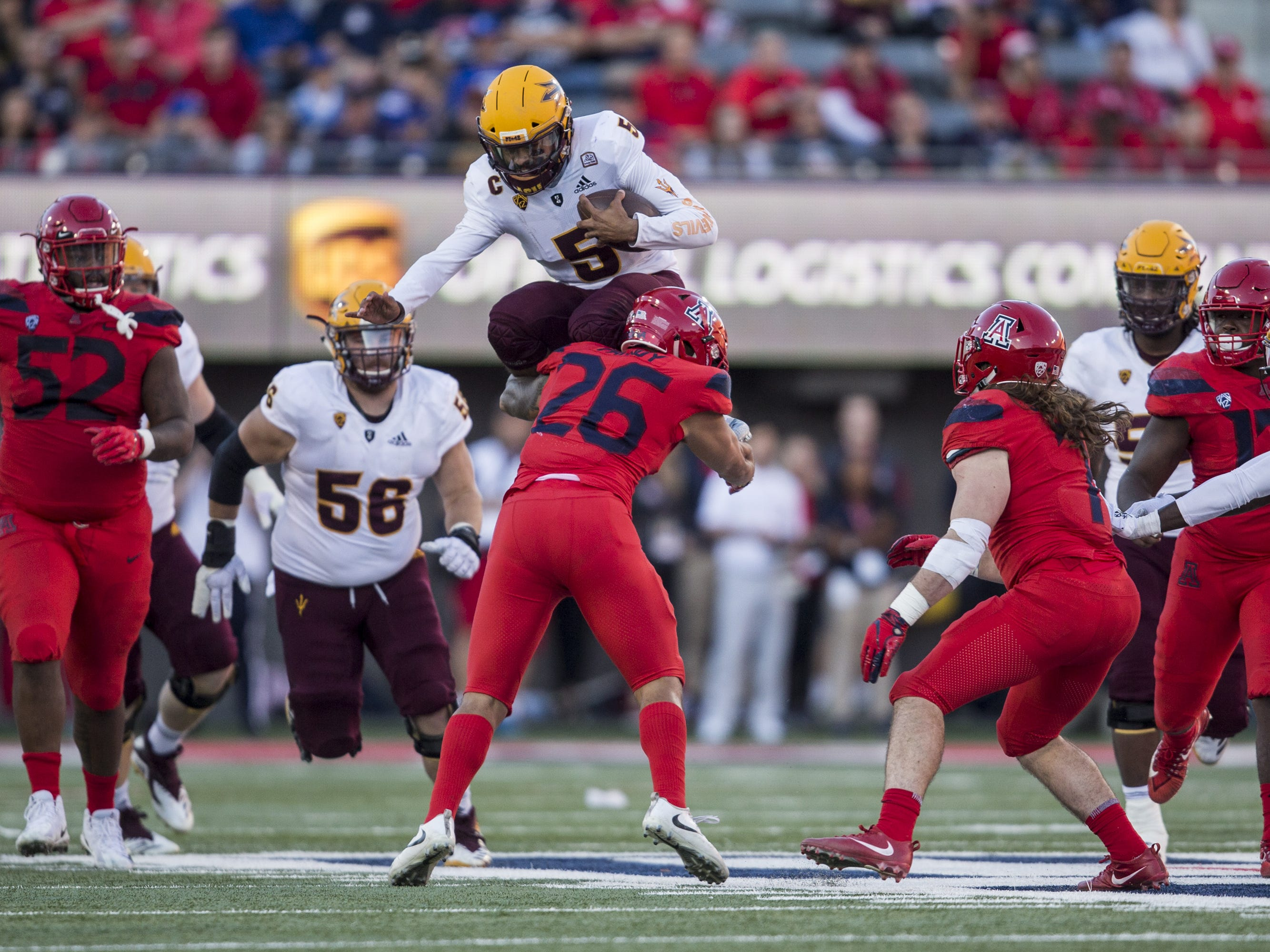 Arizona State's Manny Wilkins attempts to hurdle Arizona's Anthony Pandy during the second half of the Territorial Cup on Saturday, Nov. 24, 2018, at Arizona Stadium in Tucson, Ariz. Arizona State won, 41-40.