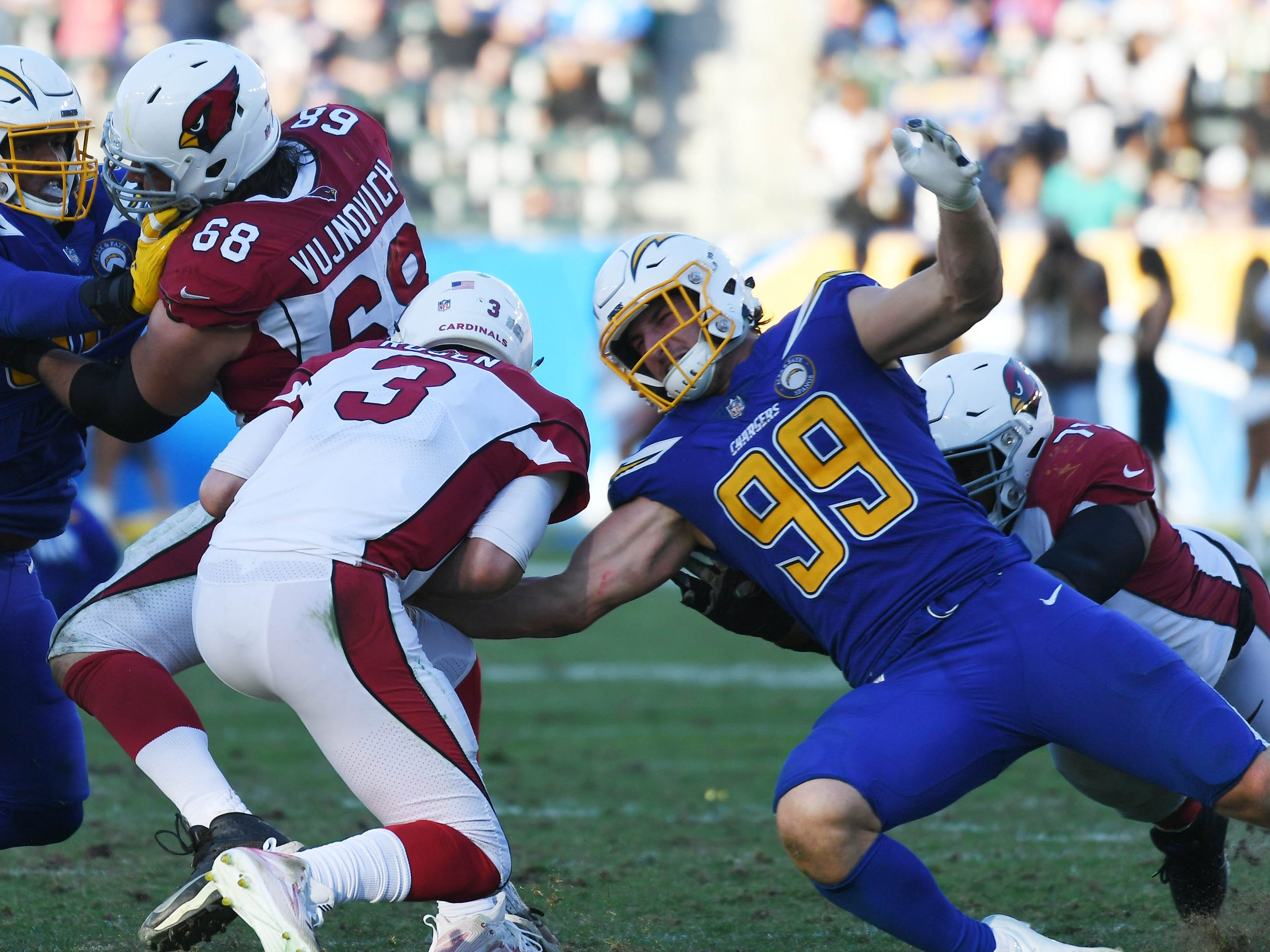 Nov 25, 2018; Carson, CA, USA; Arizona Cardinals quarterback Josh Rosen (3) is sacked by Los Angeles Chargers defensive end Joey Bosa (99) in the second half at the StubHub Center.