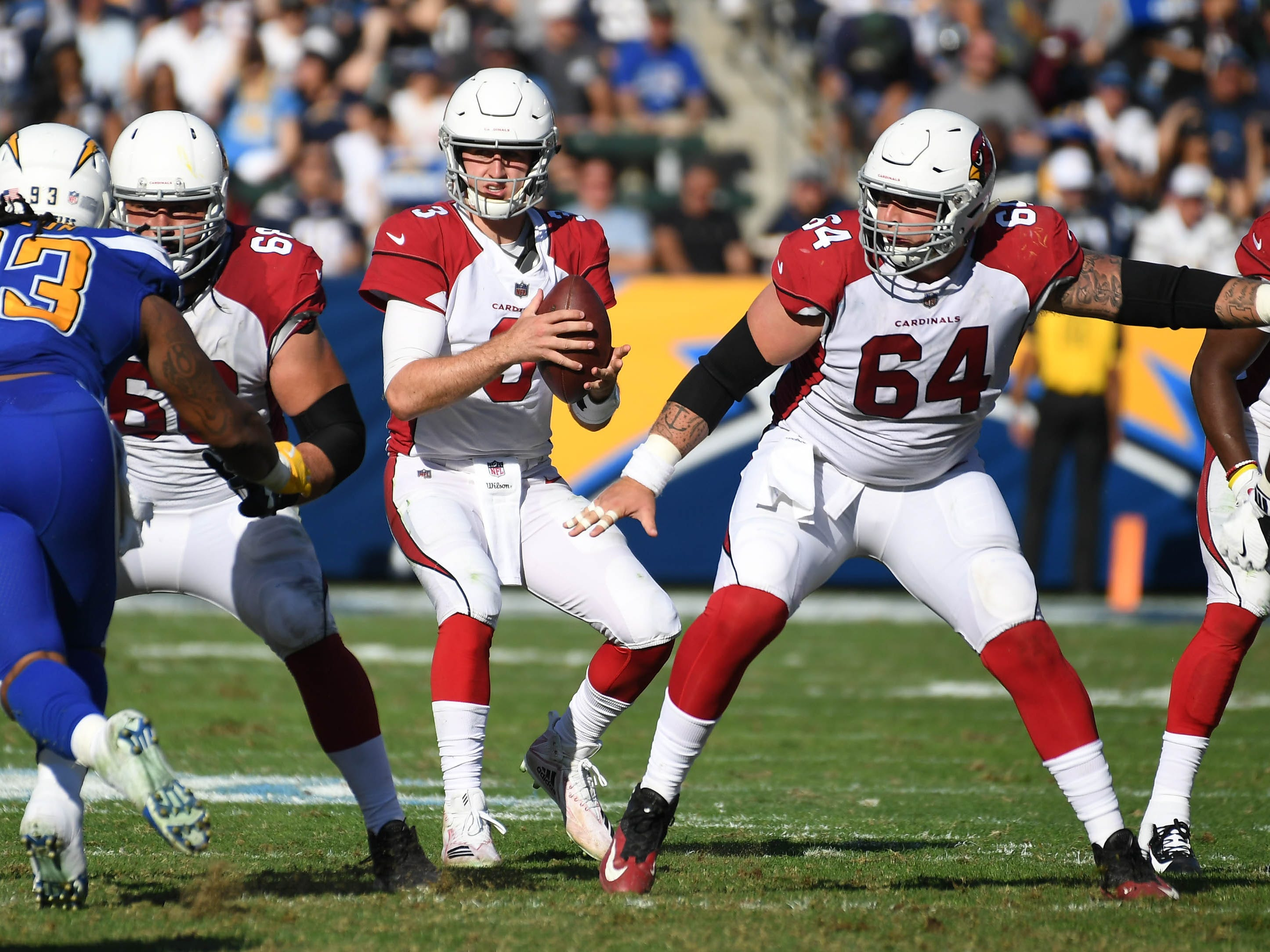 Nov 25, 2018; Carson, CA, USA; Arizona Cardinals quarterback Josh Rosen (3) drops back to pass against the Los Angeles Chargers in the first half at the StubHub Center. Mandatory Credit: Richard Mackson-USA TODAY Sports