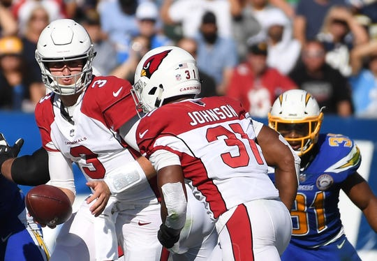 Cardinals quarterback Josh Rosen hands the ball off to running back David Johnson during a game against the Chargers at StubHub Center.