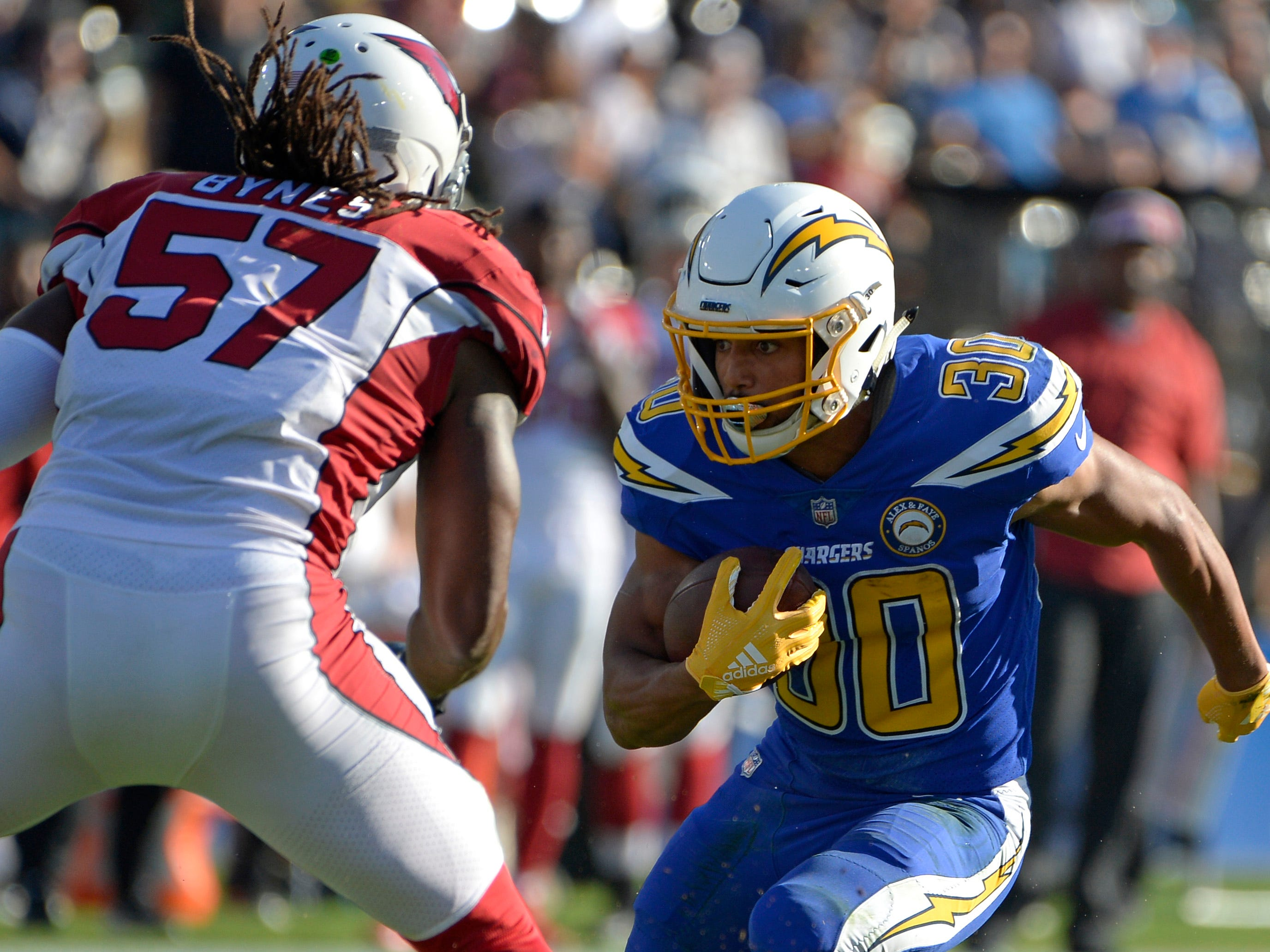 Nov 25, 2018; Carson, CA, USA; Los Angeles Chargers running back Austin Ekeler (30) is defended by Arizona Cardinals middle linebacker Josh Bynes (57) during the second quarter at StubHub Center.