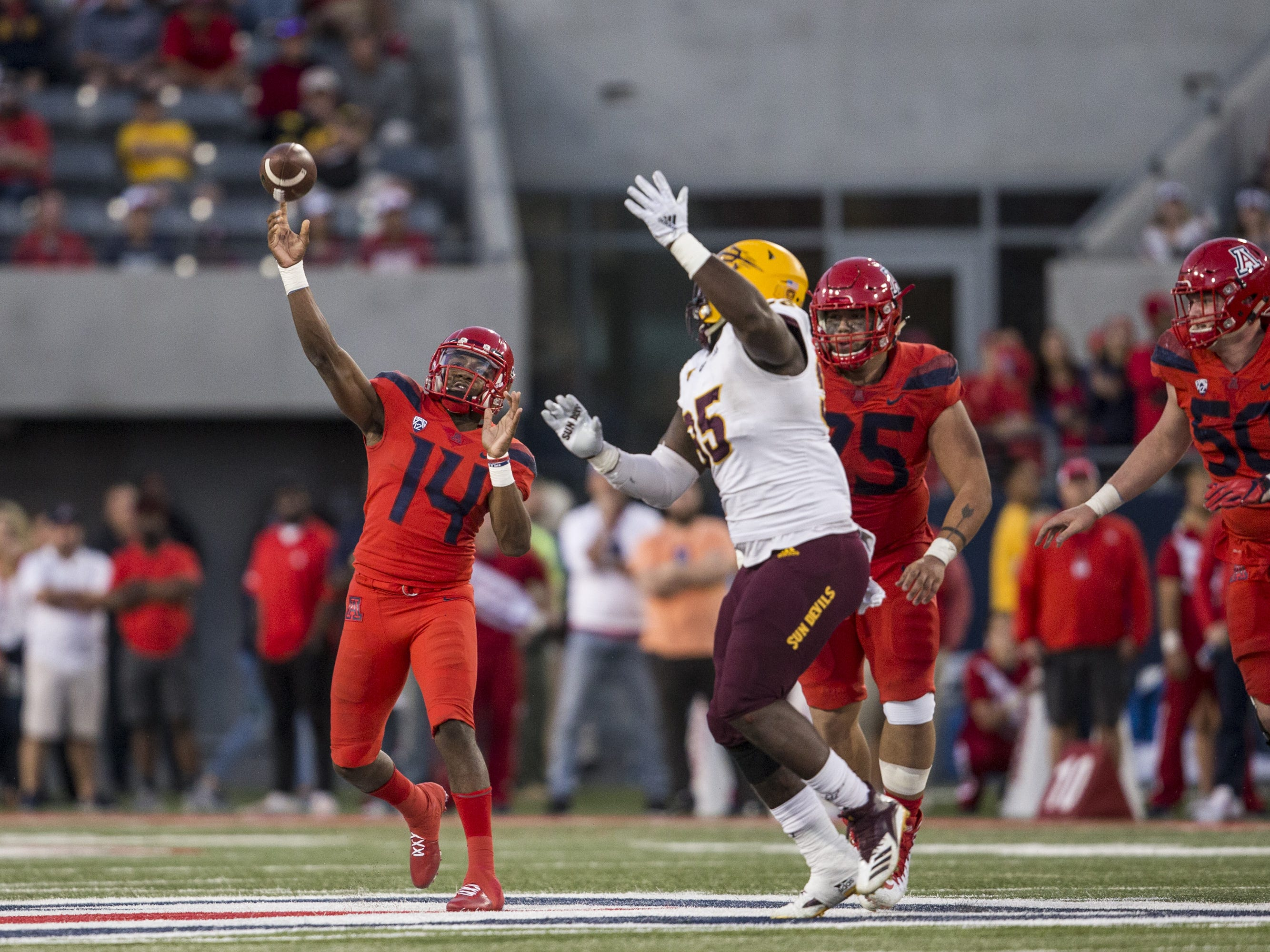 Arizona's Khalil Tate throws against Arizona State during the second half of the Territorial Cup on Saturday, Nov. 24, 2018, at Arizona Stadium in Tucson, Ariz. Arizona State won, 41-40.