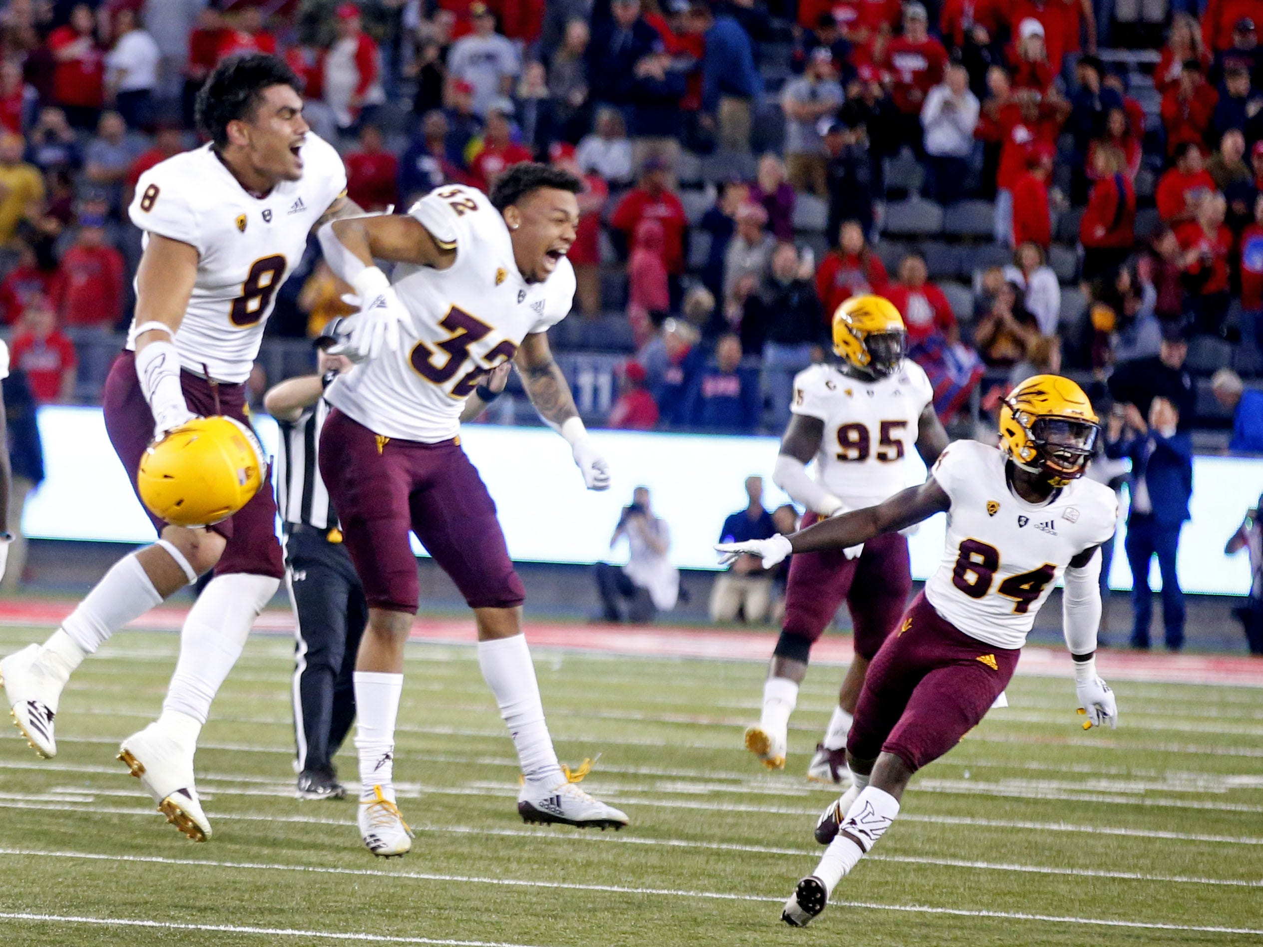 Arizona State Sun Devils players celebrate celebrate after Arizona Wildcats missed a field goal during the Territorial Cup football game at Arizona Stadium in Tucson on November 24.