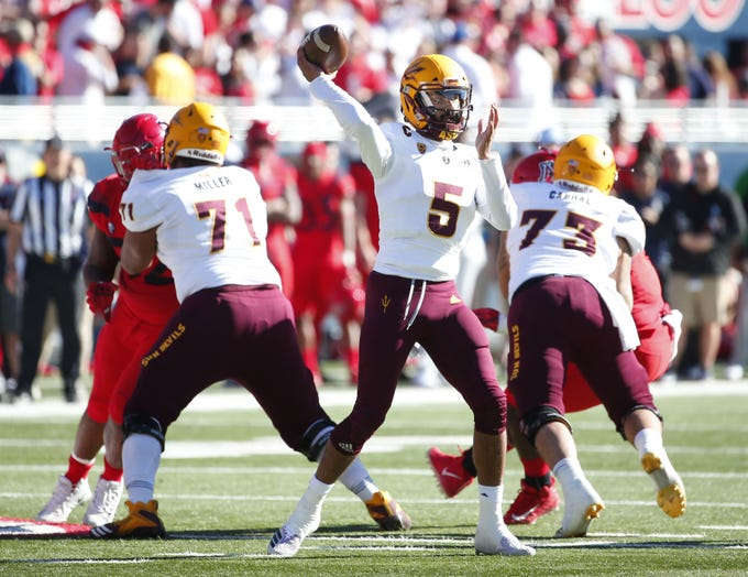 Arizona State Sun Devils quarterback Manny Wilkins (5) looks to pass during the Territorial Cup football game against the Arizona Wildcats at Arizona Stadium in Tucson on November 24.