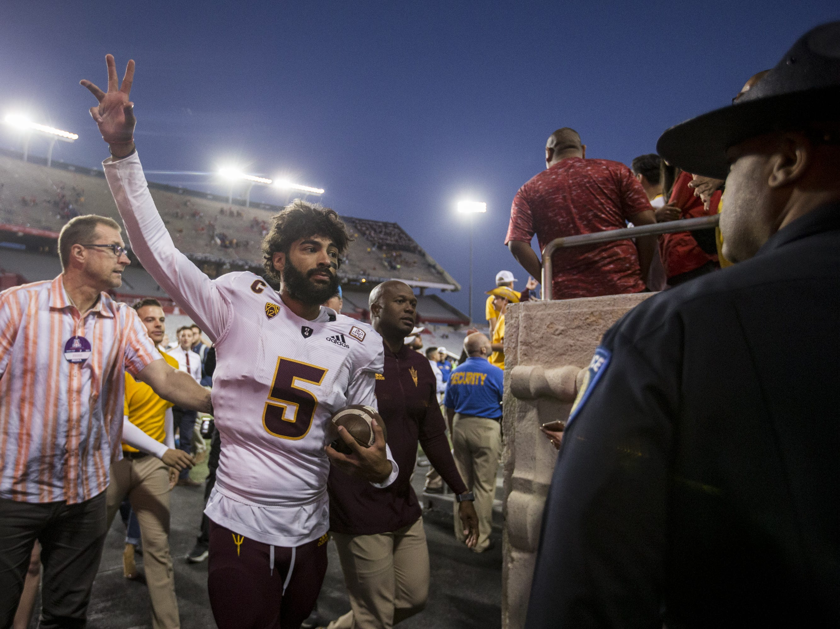 Arizona State's Manny Wilkins celebrates after defeating Arizona for the Territorial Cup on Saturday, Nov. 24, 2018, at Arizona Stadium in Tucson, Ariz. Arizona State won, 41-40.