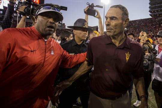 Arizona head coach Kevin Sumlin congratulates Arizona State head coach Herm Edwards after Arizona State won the Territorial Cup on Saturday, Nov. 24, 2018, at Arizona Stadium in Tucson, Ariz. Arizona State won, 41-40.