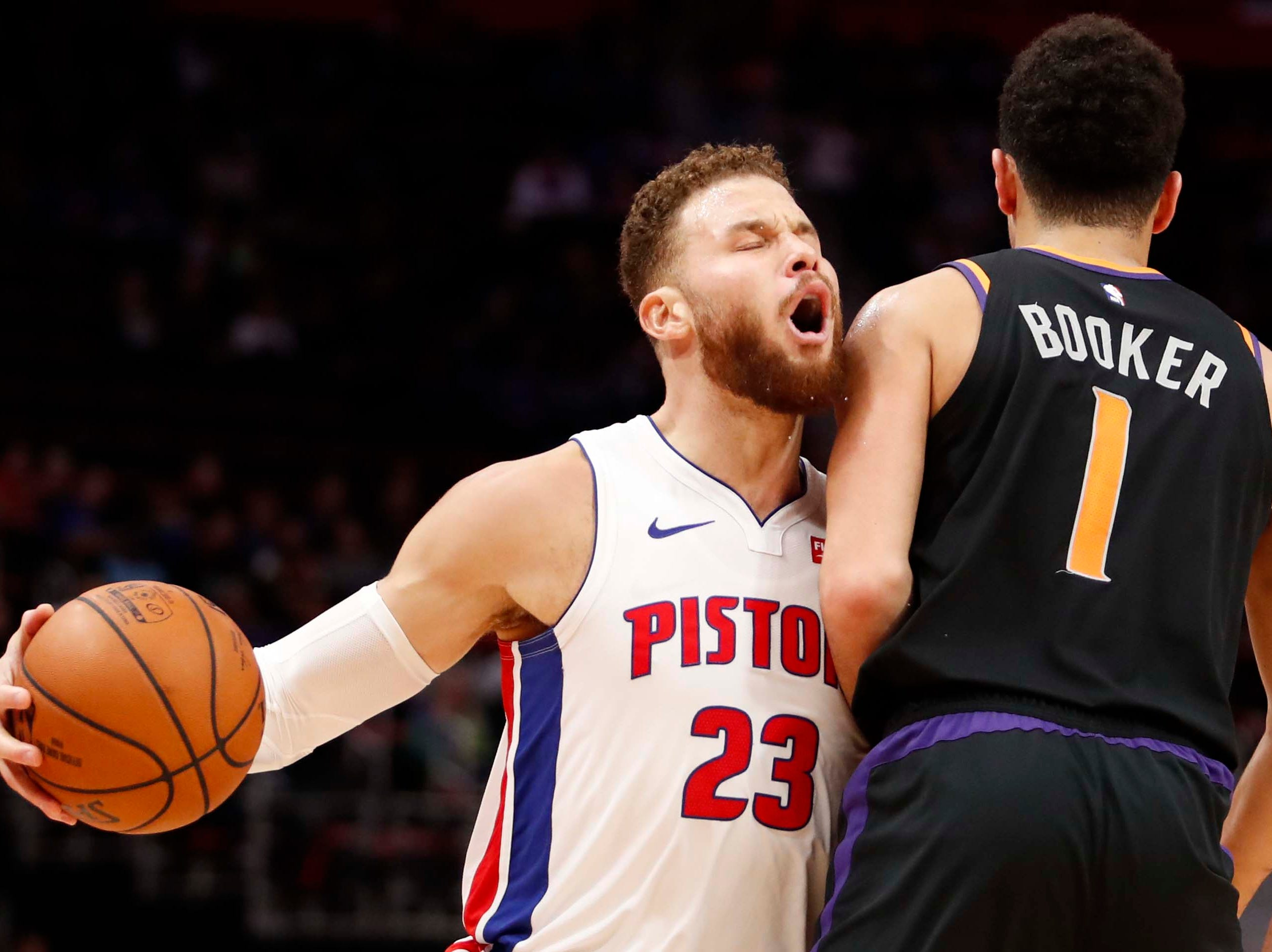 Nov 25, 2018; Detroit, MI, USA; Detroit Pistons forward Blake Griffin (23) runs into Phoenix Suns guard Devin Booker (1) during the second quarter at Little Caesars Arena. Mandatory Credit: Raj Mehta-USA TODAY Sports